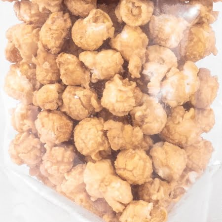 close up of bag of Sea Salted Maple Popcorn coated in Pure Canadian Maple Syrup