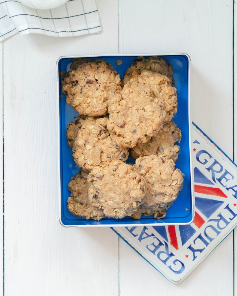 Maple and Date Oat Cookies - cookies in a tin with lid placed underneath - Pure Maple Syrup