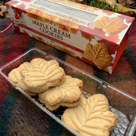 Opened box of Turkey Hill Maple Cream Cookies on a picnic blanket