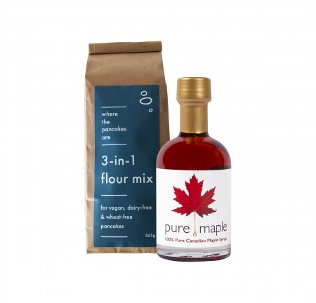 Amber Rich Maple Syrup bottle and bag of 3 in 1 flour mix for wheat-free, dairy-free, vegan pancakes blue label