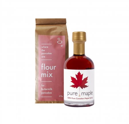 Amber Rich Maple Syrup bottle and bag of flour mix for buttermilk pancakes pink label