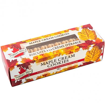 box of turkey hill maple cream cookies, red box covered in maple leaves with a window showing maple cookies inside