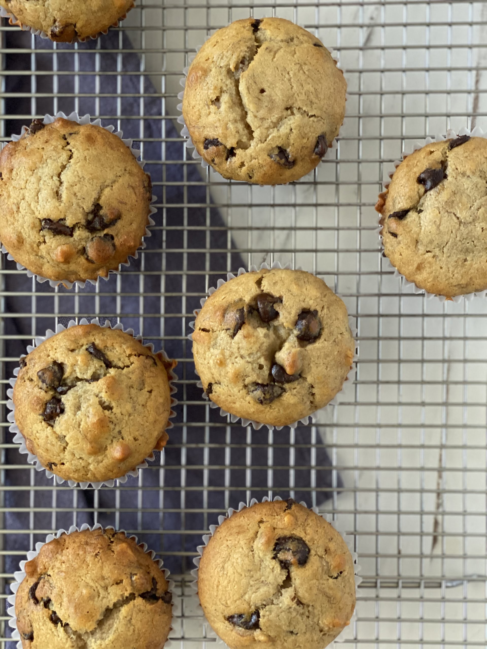 Vegan Friendly Chocolate Chip Banana Nut Muffins on a wire rack