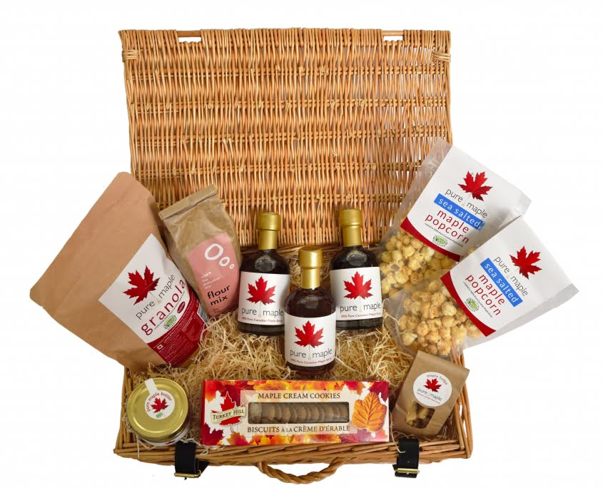 Christmas Hamper Gift Basket filled with maple syrup based products including 3 bottles of Pure Maple Syrup, jar of Pure Maple Butter, 2 bags of Pure Maple Sea Salted Popcorn, a bag of Pure Maple Fudge and many more maple products