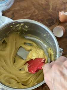 Mixing eggs into the churro dough