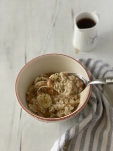 Peanut butter and banana porridge with mixed seeds and maple syrup