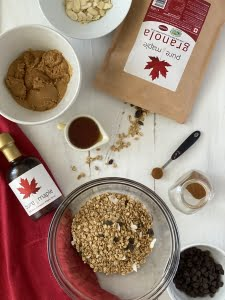 Ingredients maple granola, maple syrup, peanut butter, cinnamon, almonds, chocolate