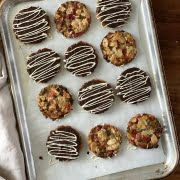 Ginger, Cherry and Maple Florentines covered in dark chocolate with a drizzle of white chocolate for decoration - Pure Maple Syrup
