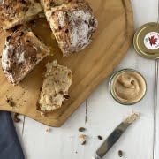 Maple Fruity Soda Bread with a quarter cut and a slice with Pure Maple Butter on it - Pure Maple