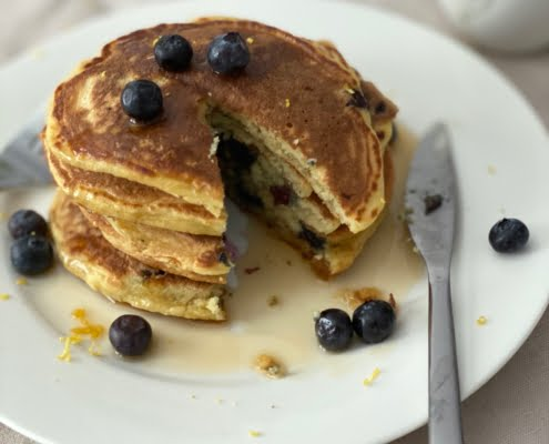 Lemon and Blueberry Ricotta Pancakes with a section cut out - Pure Maple
