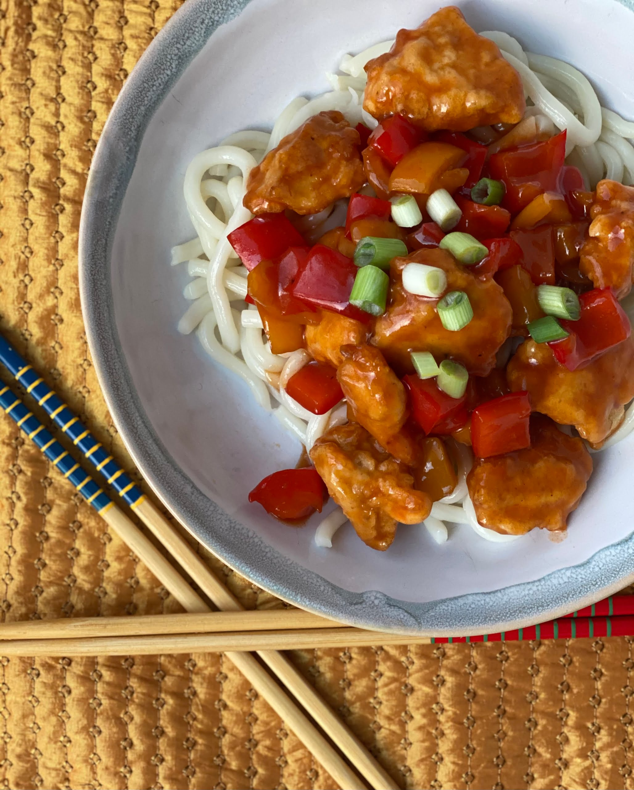 Sweet and Sour Chicken with noodles and spring onion garnish- Pure Maple