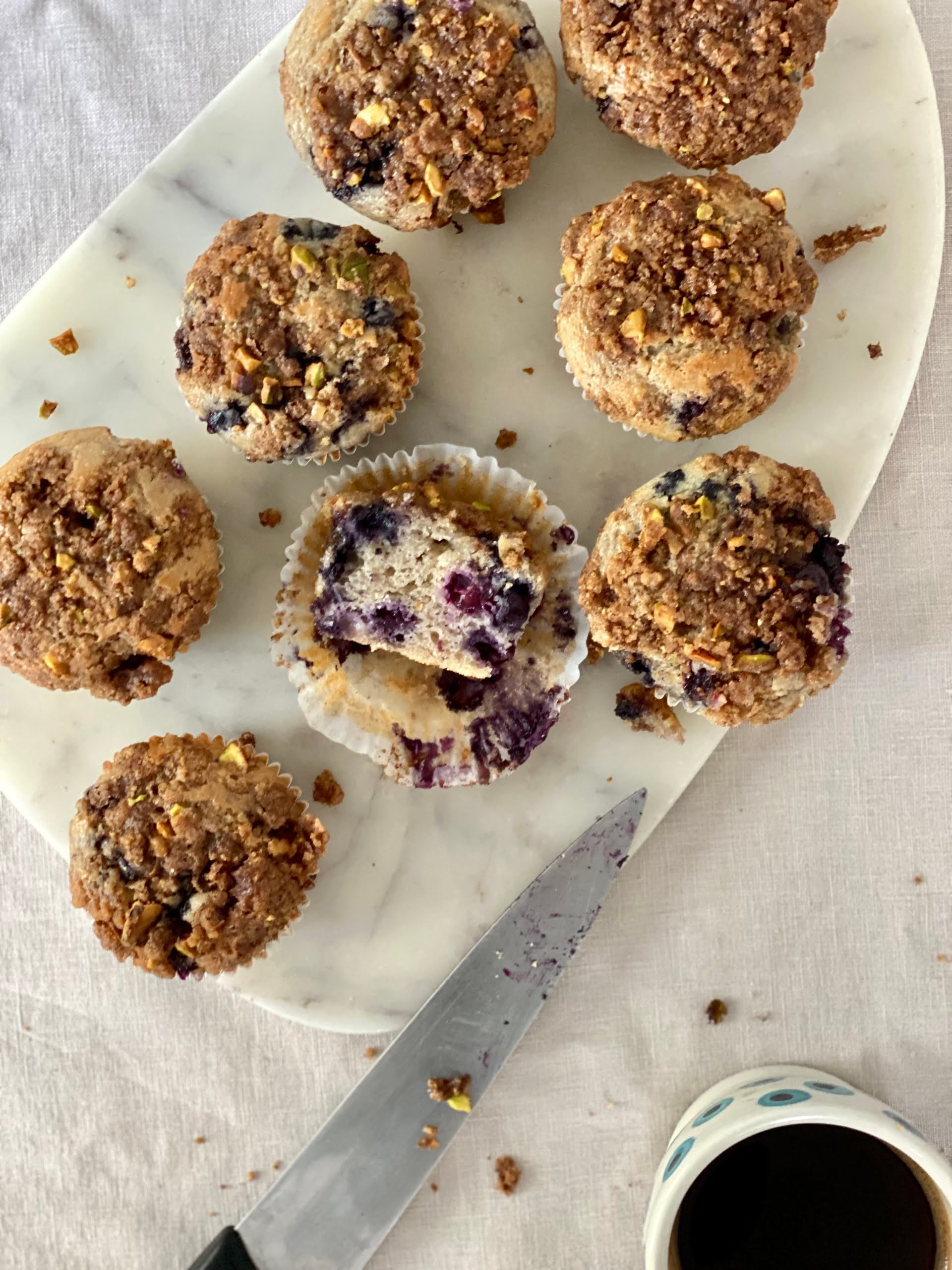 Maple Blueberry Muffins with Nutty Streusel Topping and 1 muffin cut in half - Pure Maple